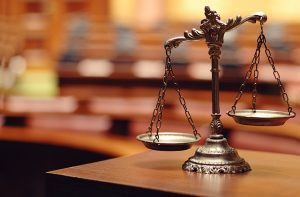 Scales-of-justice-in-a-court-room-300x197
